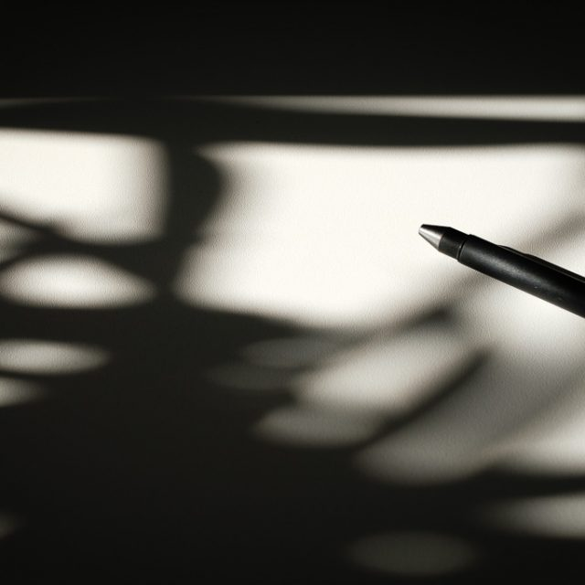 morning shadow on the office desk